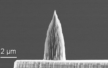 Diamond nano-tip integrated onto the micro-heater of a doped silicon microcantilever. The tip has a radius of 10nm (photo courtesy of University of Illinois College of Engineering)