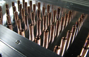 Photonic crystal for a 6 gigahertz laser. The regular arrangement of the rods provides the unique properties that manipulate the laser beam