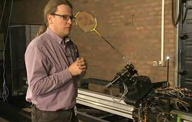 Wim Symens alongside his badminton playing robot
