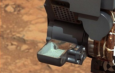 An image (courtesy of NASA) of the drill's rock powder held in the scoop