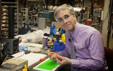 University of Virginia physicist Lou Bloomfield with a new type of silicone rubber he has developed, called Vistik (photo courtesy of The University of Virginia)