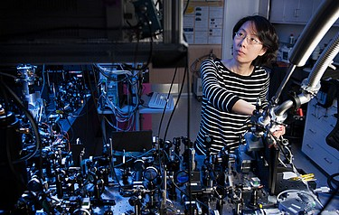 Physicist Na Young Kim, at the optical bench, is a member of the international team that has demonstrated a revolutionary electrically driven polariton laser