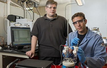 University of Delaware Professor Joel Rosenthal (left) and doctoral student John DiMeglio at work in Rosenthal's lab in the UD Department of Chemistry and Biochemistry