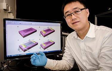 NTU's Professor Wang Qijie shows the thin and flexible photodetector which he and his team have fabricated from pure graphene