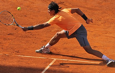 Nadal in action on a clay court (photo: Marianne Bevis)