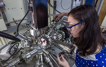Fang Xu, a Stony Brook University PhD student working with the Brookhaven Lab team, using the ambient-pressure scanning tunnelling microscope used in these experiments