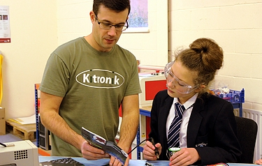 Kitronik co-founder, Kevin Spurr teaching soldering skills to a student