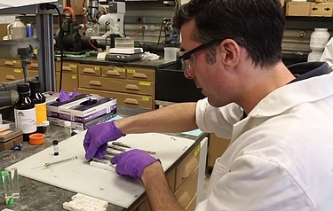 Professor Jonathan Wilker at work in his lab