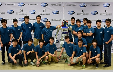 Winning team KAIST of Daejeon, Republic of Korea, and its robot DRC-Hubo